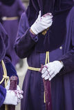 Detail penitent white holding a candle during Holy Week. Spain Stock Image