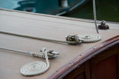 Neat coiled ropes on a wooden boat stock photo