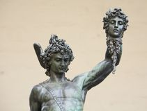 Detail of Perseus with the head of medusa, Florence, Italy. Detail of Perseus with the head of medusa, Piazza della Signoria, Florence, Italy Royalty Free Stock Images