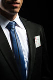 Detail photo, ace card in his suit pocket Royalty Free Stock Photography