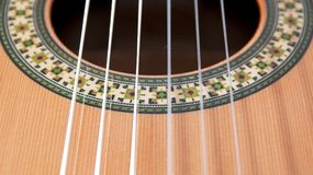 Classical guitar: strings and rosette. A detail photo of a part of a classical guitar Stock Photo