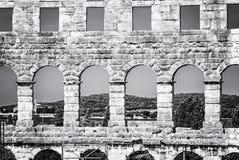 Detail photo of Pula Arena, Istria, Croatia, colorless. Detail photo of Pula Arena, Istria, Croatia. Travel destination. Ancient architecture. Black and white stock image