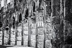 Detail photo of Pula Arena, Istria, Croatia, colorless. Detail photo of Pula Arena, Istria, Croatia. Travel destination. Ancient architecture. Black and white stock photo