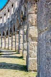 Detail photo of Pula Arena, Istria, Croatia. Travel destination. Ancient architecture. Vertical composition royalty free stock images