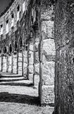 Detail photo of Pula Arena, Istria, Croatia, colorless. Detail photo of Pula Arena, Istria, Croatia. Travel destination. Ancient architecture. Vertical stock image