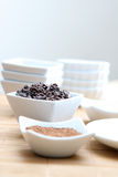 Cacao Powder and Nibs. Detail photo of raw cacao nibs and powder stock photos