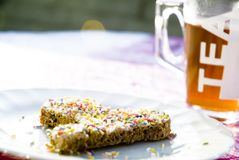 Tea time #12. A detail of a picknick table with bread and sprinkles Royalty Free Stock Photography
