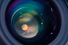 Detail picture of camera lens aperture and anti reflective coating. Detail picture of camera lens anti reflective coating, casting green and purple reflections royalty free stock photos