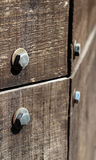 Detail piece of old wood with some bolts texture background Royalty Free Stock Photography