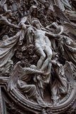 Detail of the Pieta scene in bas-relief at Milan's Cathedral doors, Royalty Free Stock Images