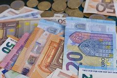 Detail of a pile of euro bills and coins royalty free stock images
