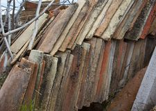 Detail of a pile of old tiles stock photos