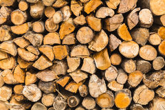 Detail of pile wooden logs texture background Stock Photo