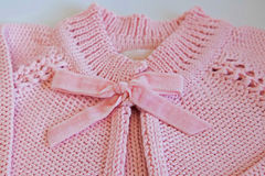Detail of pink baby blouse made of tricot Royalty Free Stock Photo