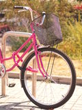 Detail of pink bicycle front. With front wheel and handlebar stock photos