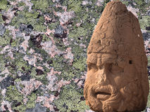 Detail, pink granite and grey, black and blue lichens Stock Image