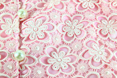 Detail of pink lace fabric with pearl Royalty Free Stock Photo