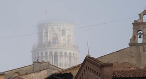 Detail of the Pisa tower in a foggy day royalty free stock image