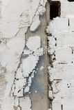Plaster spall on the wall of a rough building in Caceres, Extremadura, Spain. royalty free stock image