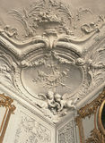 Detail of plaster work on ceiling and walls at Versailles Palace. Versailles, France - 13 August 2014 : Detail of plaster work on ceiling and walls at Versailles Royalty Free Stock Photos