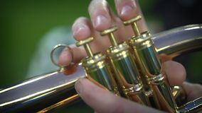 Detail of the player`s fingers on trumpet. Pipes in the hands of musicians stock video footage