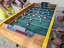 Mini football game table in close up view. Detail of players on mini football game on table on the beach royalty free stock images