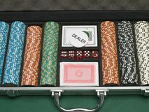Detail of poker chips, playing cards, and dice Stock Photos