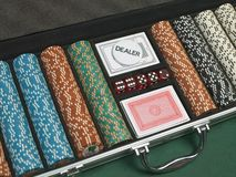 Detail of poker chips, playing cards, and dice Stock Images