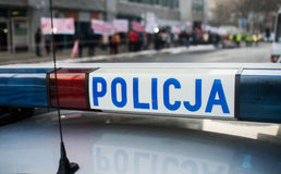 Detail of a police Policja car in Poland, demonstration in bac Royalty Free Stock Photos