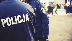 Detail of a police Policja officer in Poland, demonstration in. Background, vintage effect Royalty Free Stock Photos