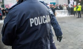 Detail of a police Policja officer in Poland, demonstration in. Background Royalty Free Stock Photo