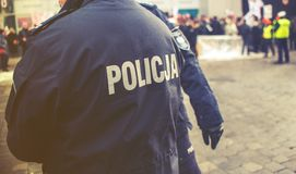Detail of a police Policja officer in Poland, demonstration in. Background, vintage effect Stock Image