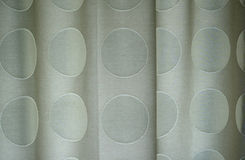 Detail of polka dotted curtains. Close up of polka dotted curtains with folds in the fabric Stock Photos