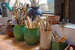 Detail from pottery work room - brushes Royalty Free Stock Images
