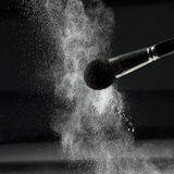 Detail of a powder brush with white loose powder Royalty Free Stock Photos