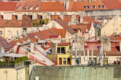 Detail on the Prague cityscape and old buildings in late afternoon sun, Czech republic Stock Images
