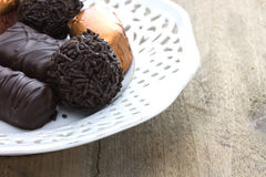 Detail of pralines on a classic plate Royalty Free Stock Photography