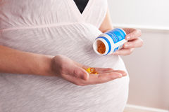 Detail Of Pregnant Woman Taking Vitamins Stock Images