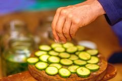 Detail of preparation of healthy cucumber snack - raw food. Detail of preparation of healthy cucumber snack - raw food Royalty Free Stock Images