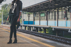 Detail of a pretty girl posing in a metro station Stock Photos