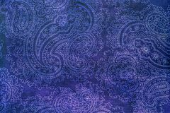 Old elaborate paisley pattern on paper. A detail from a print of an ornate bright blue paisley pattern Royalty Free Stock Photos