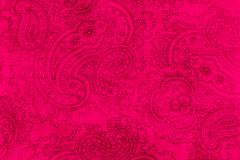 Old elaborate paisley pattern on paper. A detail from a print of an ornate bright pink paisley pattern Royalty Free Stock Photo