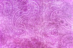 Old elaborate paisley pattern on paper. A detail from a print of an ornate bright pink paisley pattern Royalty Free Stock Photos