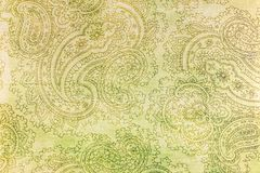 Old elaborate paisley pattern on paper. A detail from a print of an ornate cream coloured paisley pattern Royalty Free Stock Photo