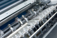Detail of a printing press 1. Detail of the sheet feeder of an offset printing press Stock Photo