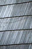 Detail of protective wooden shingle on roof Stock Photo