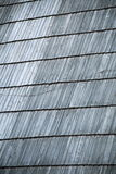 Detail of protective wooden shingle on roof Stock Images