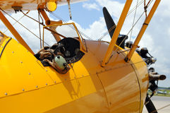 Detail of PT-17. Vintage airplane detail showing cockpit and pilot gear Royalty Free Stock Photography