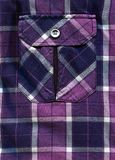 Purple shirt pocket and buttons royalty free stock photo