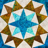 Detail of the quilt. From pieces of fabric royalty free stock photo